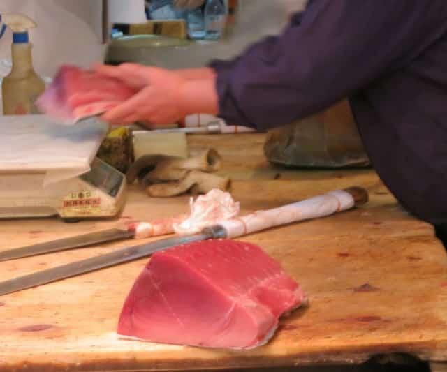 Butchers Portion out Fresh Tuna Tsukiji Market Tokyo Japan tsukiji market sushi breakfast
