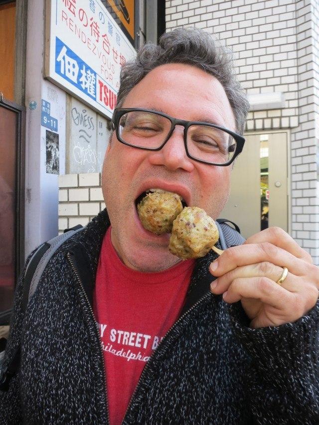 Daryl enjoys a fish ball Tsukiji Market Tokyo Japan tsukiji market sushi breakfast