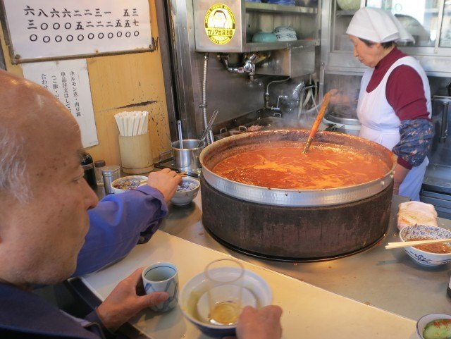 Workers and Locals Enjoying Stew Outside Tsukiji Market in Tokyo Japan