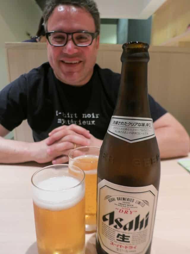 Daryl waits patiently - with beer. Ramen Street Tokyo Japan