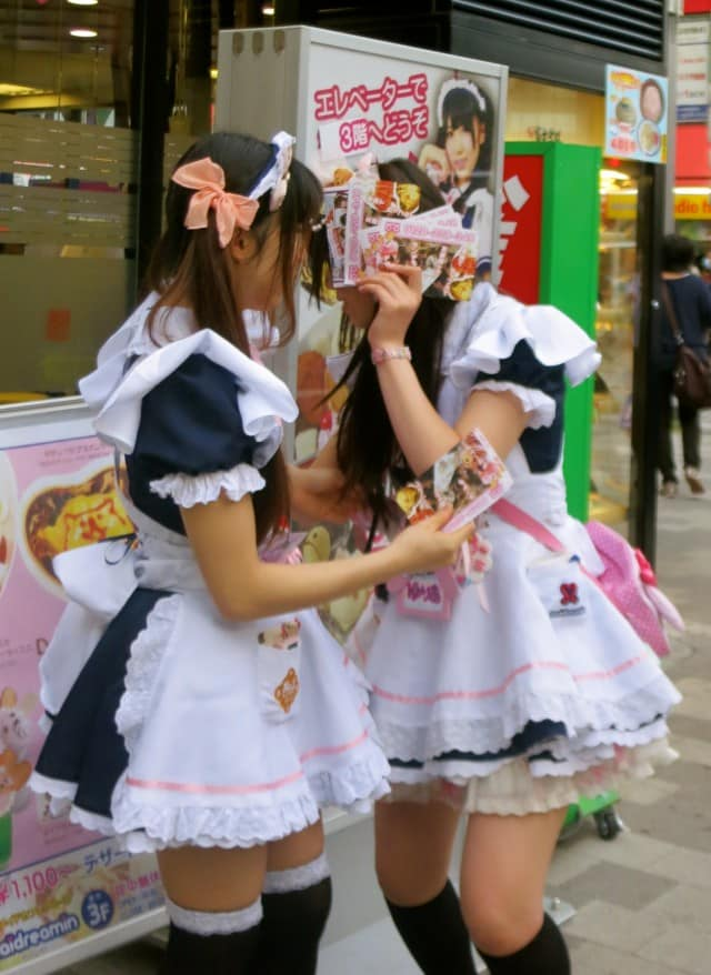 Maids Hiding their Faces in Tokyo Japan - Akihabara and Otaku Culture