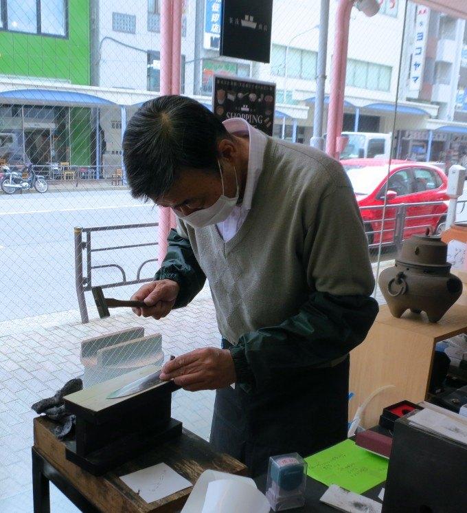 Artisan Knife Engraver at Kama-As on Kappabashi Street in Tokyo Japan