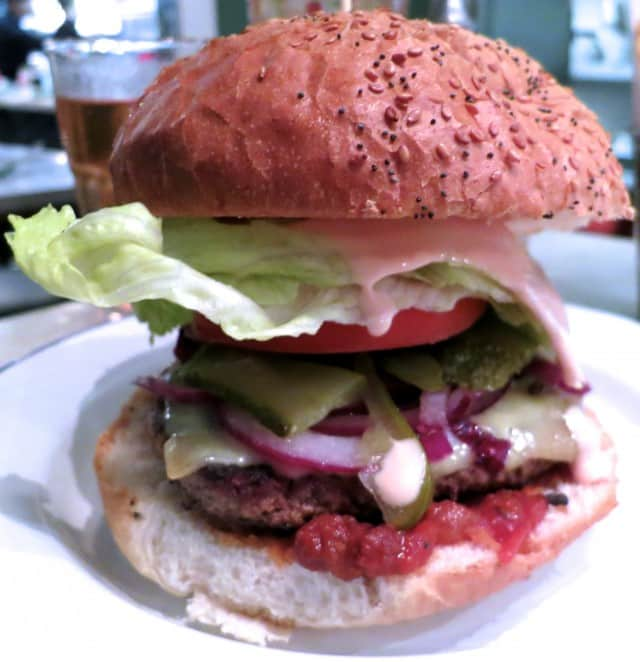 The Dubliner Burger with Beef Tomato, Iceberg Lettuce, Old Dubliner Cheddar Cheese, Fried Onion, Gherkins, Tomato Relish and Special Sauce Normal Food