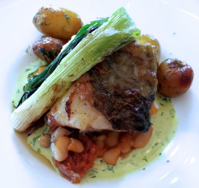 Baked Cod with a Chorizo and Cannellini Bean Casserole and a Herb Cream; Served with Vegetables and Potatoes of the Day Dublin Day Trip