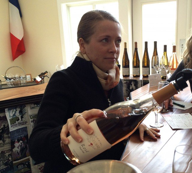 Céline Leseurre Pouring Wine for our Tasting. 5 Tasting Spots in the Finger Lakes 2foodtrippers