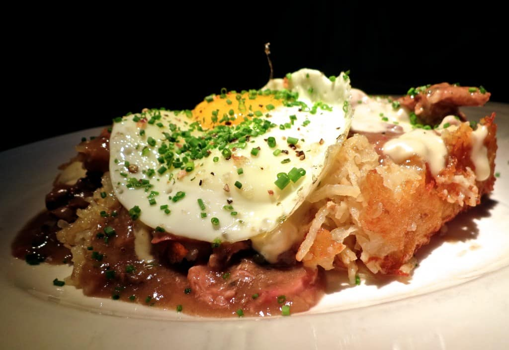 Crispy Potato Hash with Duck Heart Gravy at Au Cheval in Chicago Illinois