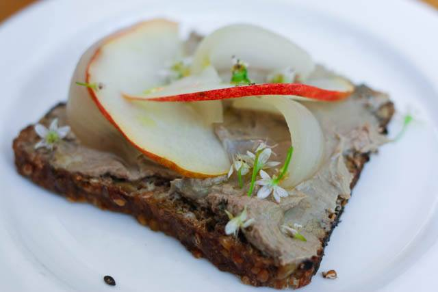Chicken Liver Pate Tartine with Bartlett Pear and Pickled Cipollini Onion on Sprouted Rye Bread at Bar Sajor in Seattle. The restaurant, located off of Pioneer Square, provided our first taste of Seattle's modern dining scene.