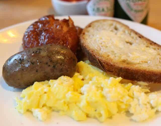 Lola Breakfast - Two Eggs, Maple Sausage, Smoked Bacon, Smashed Garlic Fried Potatoes and Toast ($15) Seattle