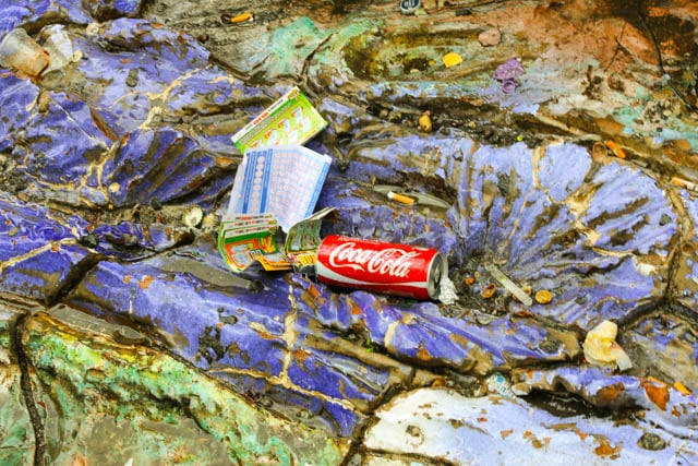 Colorful Litter of Naples - Coca Cola Can and Lottery Tickets Nestled in a Public Sculpture Naples Italy Real Italian City