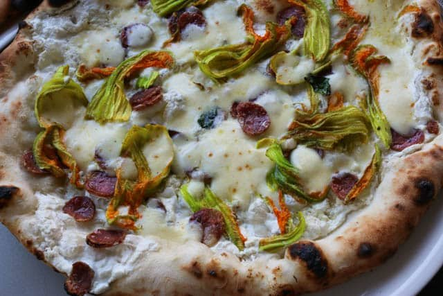 This pizza at 50 Kalò is topped with Caserta Black Pork Salami and Squash Blossoms Naples Best Pizza in the World. best pizza in naples italy