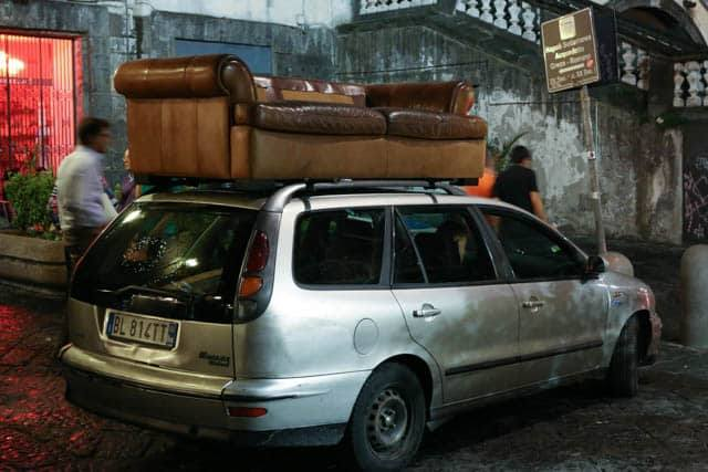 Sofa on Car on Via dei Tribunali in Naples Italy
