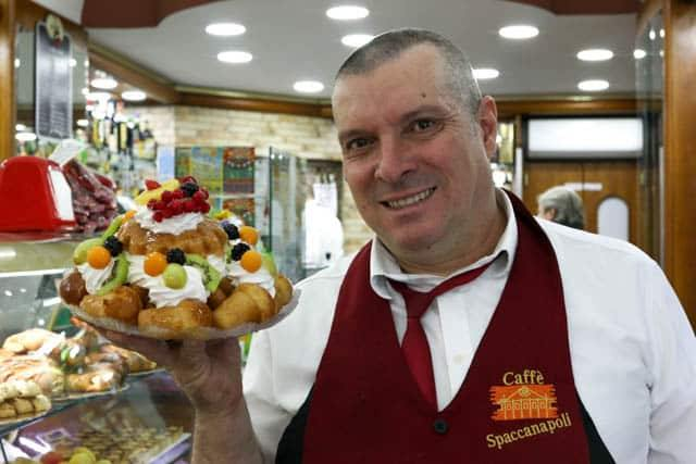 The proud people of Naples, Italy are never afraid to take advantage of a photo op to show off their fine skills. Here's our favorite Neapolitan baker with a Babba con Frutta. Naples Italy Caffe Spaccanapoli