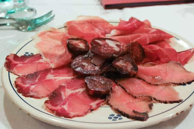 The charcuterie plate at Trattoria del Caveoso in Matera features house made lonza (bottom right). Visit Matera Italy