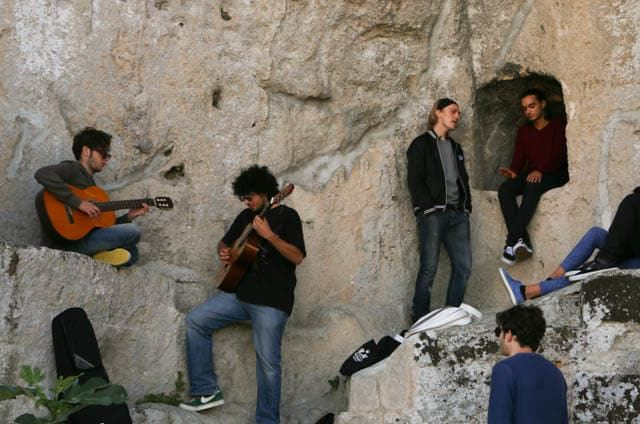 Rock Band Playing in the Rocks in Matera Italy