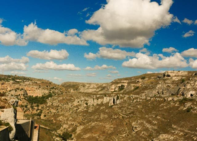 A view from the ledge of Matera's Sasso Caveoso into the canyons of Parco della Murgia Materana. Visit Matera Italy