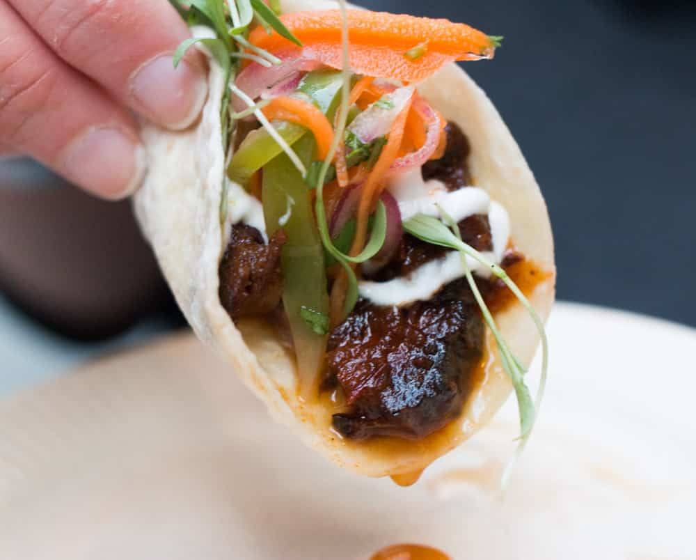 Distrito Sous Chef Josh Shapiro's sweet and spicy brisket taco highlighted many of the eclectic culinary options at this year's Brewer's Plate. The taco was paired with hand crafted cocktails from Philadelphia Distilling. Brewer's Plate 2015 Philadelphia Brewers Plate