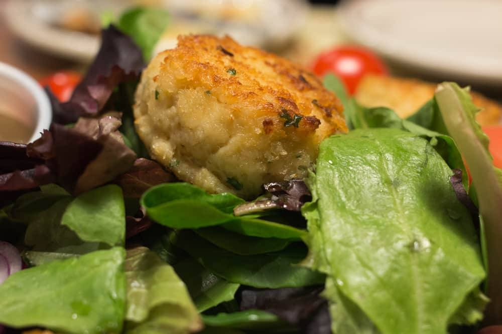 Salad with Pan-Seared Crab Cakes at Union Oyster House in Boston Massachusetts
