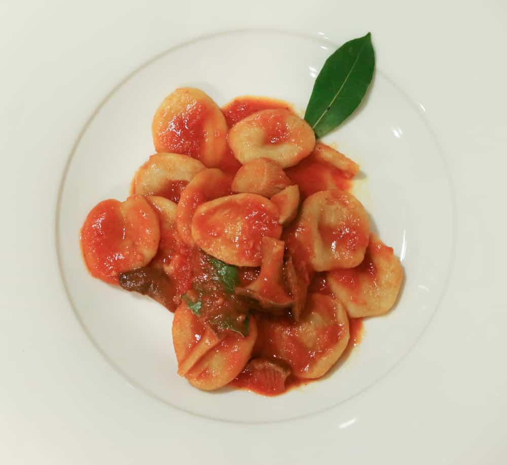 The osteria's version of Orecchiette al Sugo features tomato, basil and pepper. The orecchiette noodles are prepared larger than the normal puglian orechiette due to the chef's preference Puglia in a Day Trip to Puglia