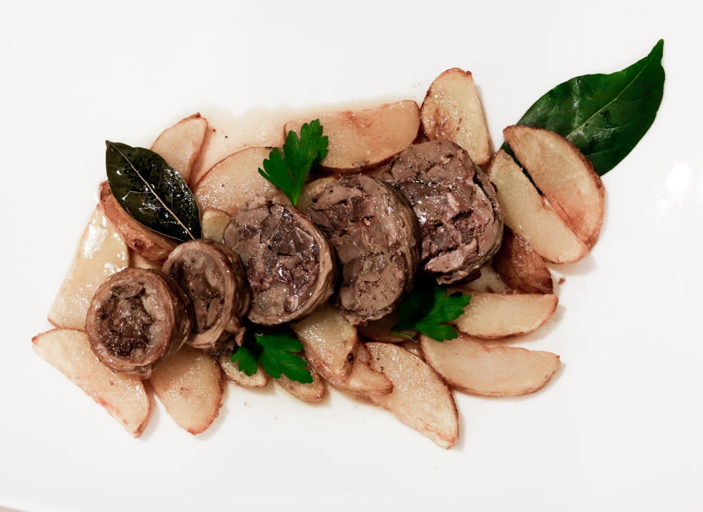 A meal highlight was the Marretto dish, a lamb roll made with organ meat served over a plate of potatoes and bay leaves. Trip to Puglia