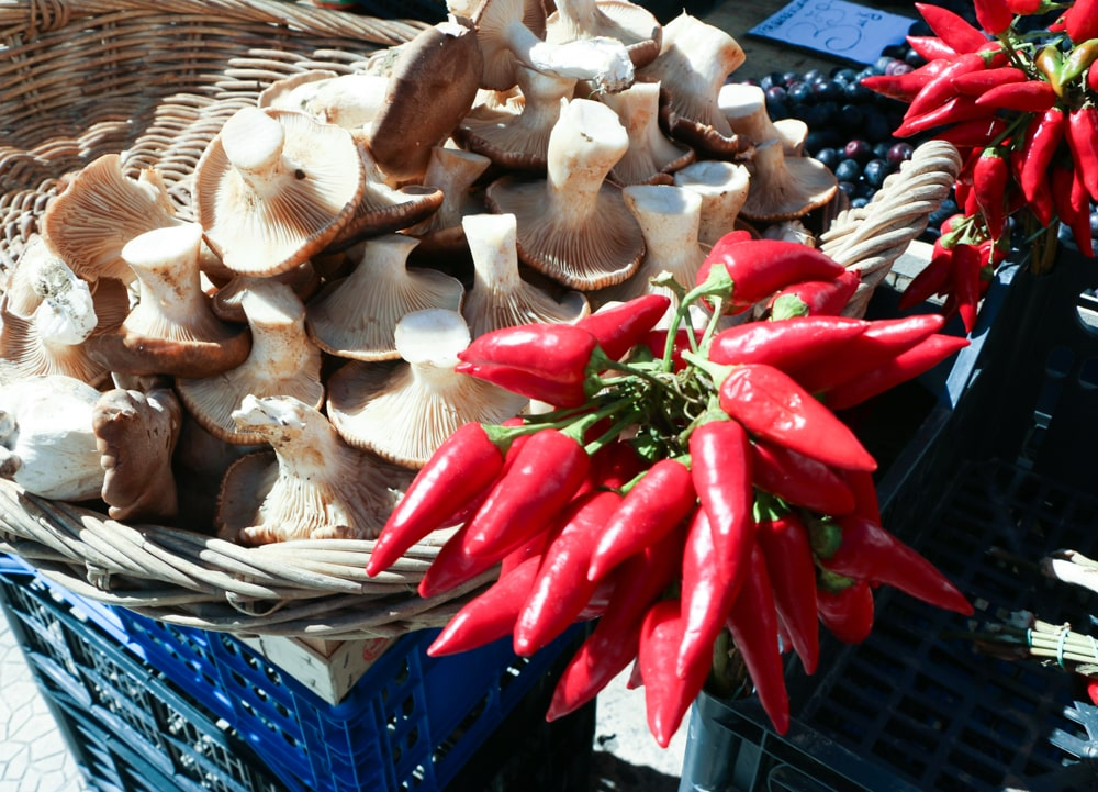 Aside from the legendary olives, Puglian markets feature other vegetables like local mushrooms and bright red, sundrenched peppers. Day Trip to Puglia