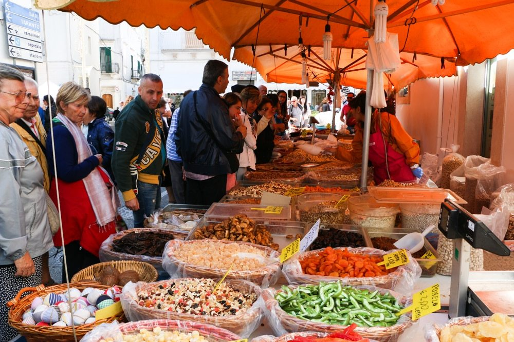 Markets in Puglia offer colorful, affordable produce prepared by local farms. Locals queue up to buy bags of the freshest olives, figs and peppers that we have ever seen. Puglia in a Day Trip to Puglia