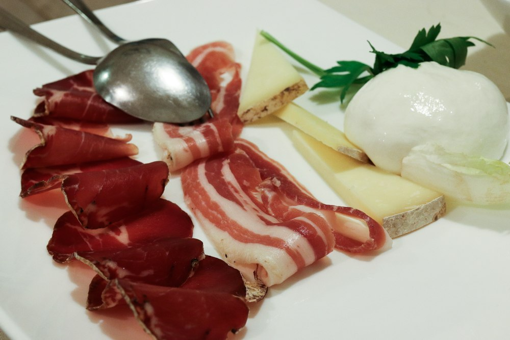 Antipasti in Puglia could be a meal on its own. Our favorite starter of the meal featured locally made meats and cheeses. Puglia in a Day Trip to Puglia