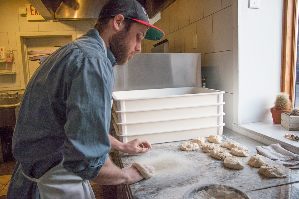 Philly Style Bagel partner Collin Shapiro hand shapes each bagel before sending over to Jonathon Zilber for the beer bath. The pop-up bagel shop operates in a pizza shop and is currently open most Sunday mornings. Bagel Wizards.