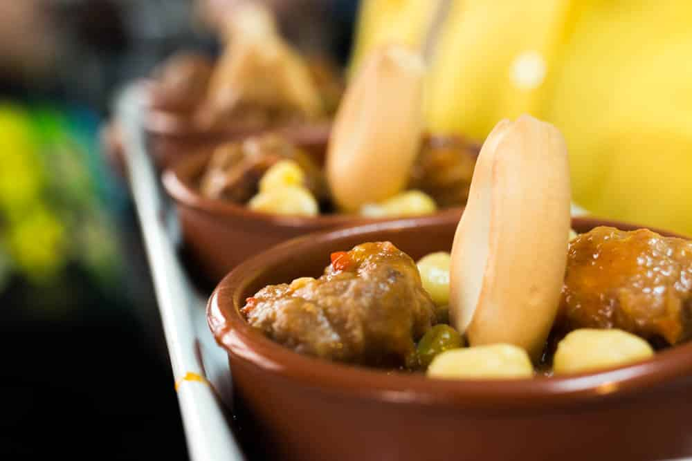 5 Ways to Eat in Barcelona. Devour Barcelona's Gràcia neighborhood food tour makes 10 delicious stops. This dish with housemade meatballs in a bean and pea gravy is just one example of the local foods eaten on the four-hour tour. 2foodtrippers Eat in Barcelona