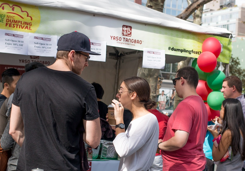 A diverse crowd queued up for dumplings at the NYC Dumpling Festival in New York's Lower East Side.