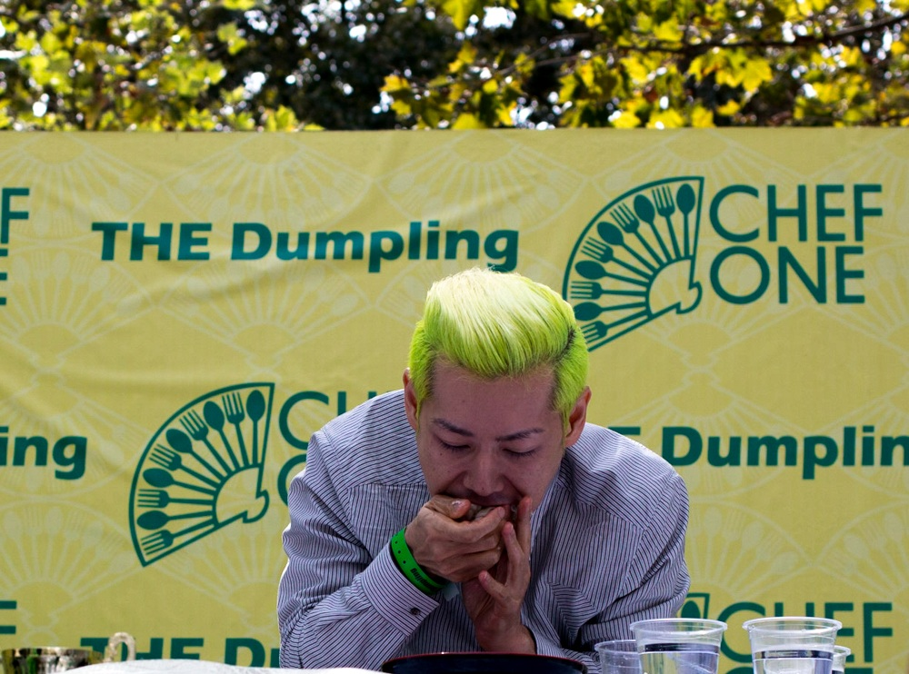 Professional competitive eater Takera Kobayashi kicked off the dumpling eating contest by eating dumplings. NYC Dumpling Festival