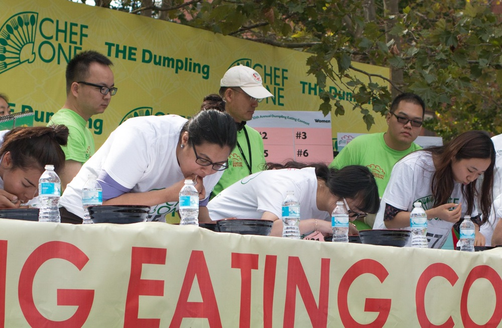 Not to be outdone by the men, the female competitors at the dumpling eating contest chowed down with gusto. The winning woman at 93 dumplings in two minutes. NYC Dumpling Festival