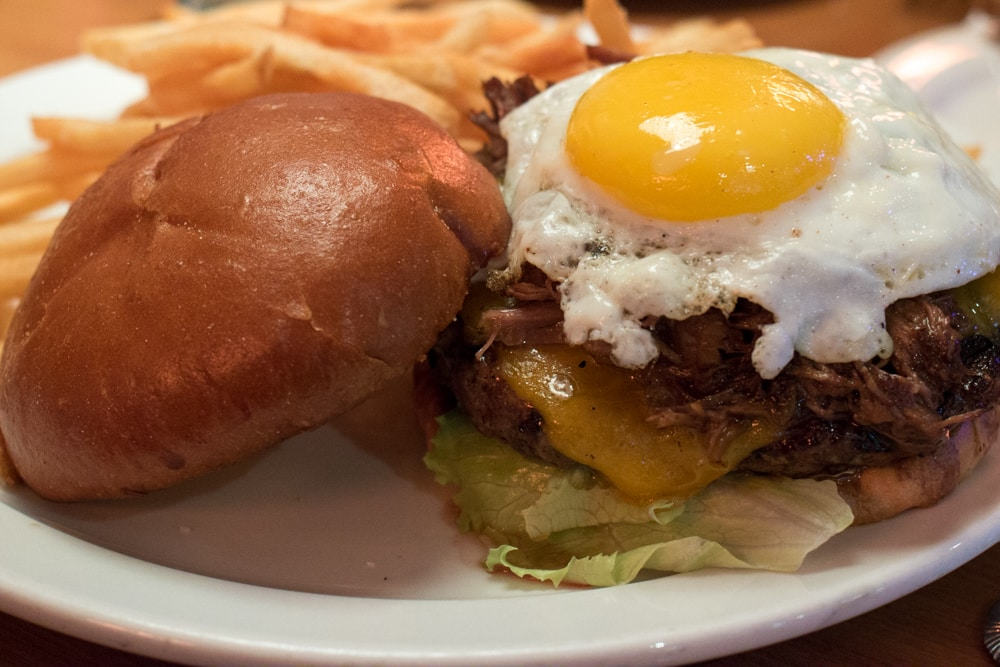 When you visitFat Choy, come for the bao but stay for the burgers. Pictured above is the Fat Choy Burger has angus beef, short rib, bacon, a fried egg and roasted tomato. las vegas off the strip