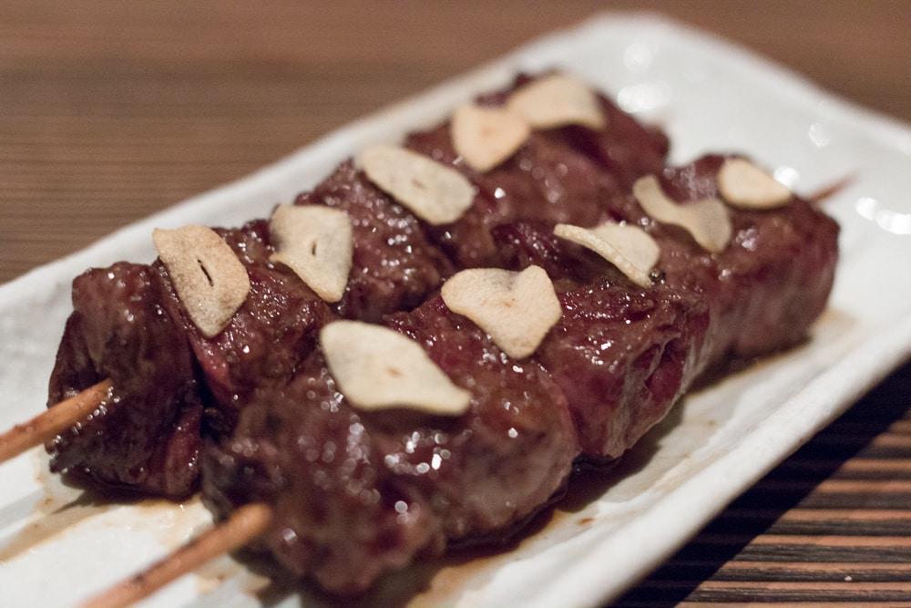 Kobe Beef on a Stick topped with Garlic. Raku in Las Vegas