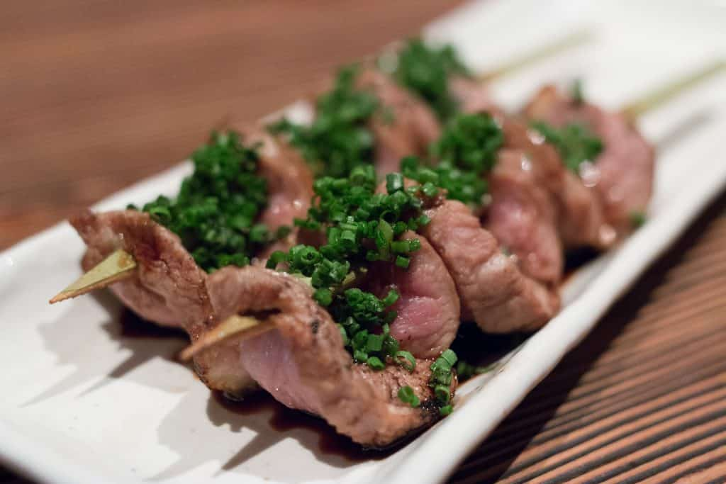 Each course at Raku is a revelation like the grilled duck shownabove. Order a bottle of saki and enjoy the savory ride. las vegas off the strip