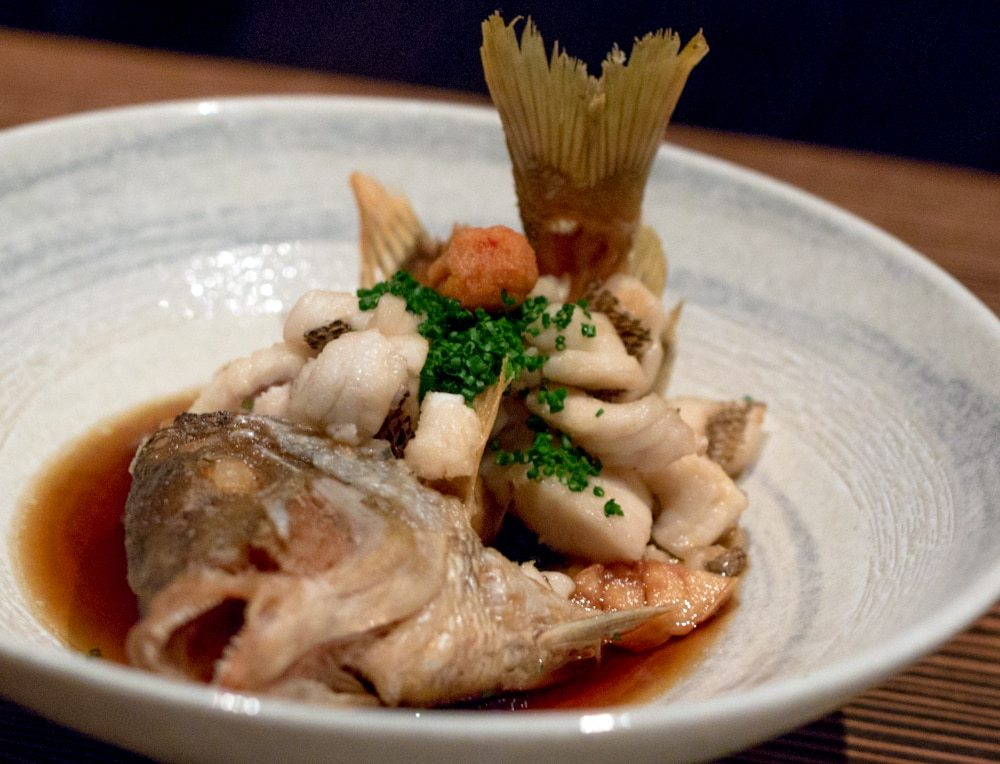 Whole Snapper Flash Fried with King Oyster Mushrooms in a Dashi Broth. Raku in Las Vegas