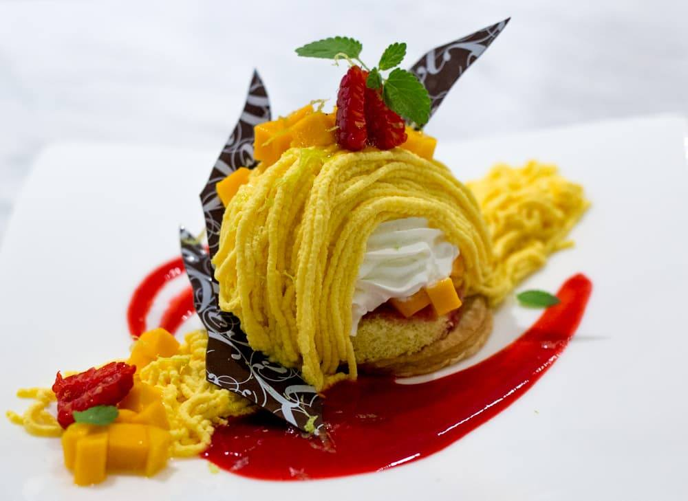 Mt. ExoticDessert -Mango Cream Cake with Homemade Pie Crust, Raspberries, Mango Pieces and Chocolate. Raku in Las Vegas