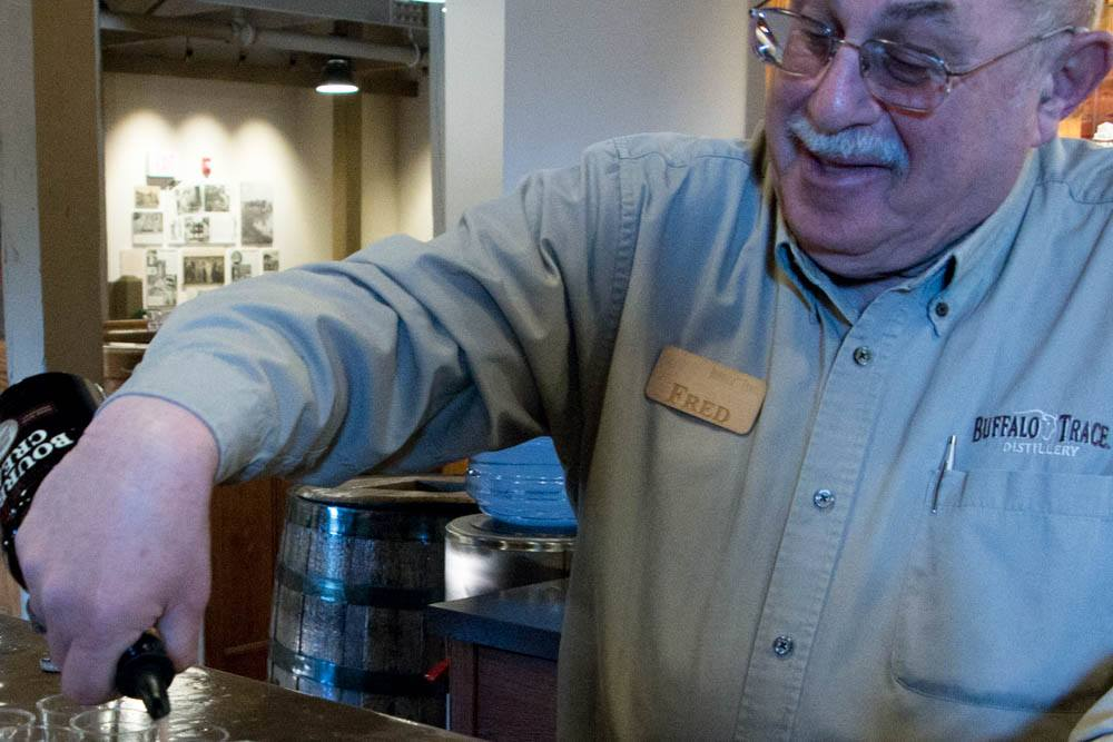 Tour guide Fred Mozenter takes pleasure in sharing his bourbon passion with tour groups. Here he is shown pouring samples at the end of our tour.