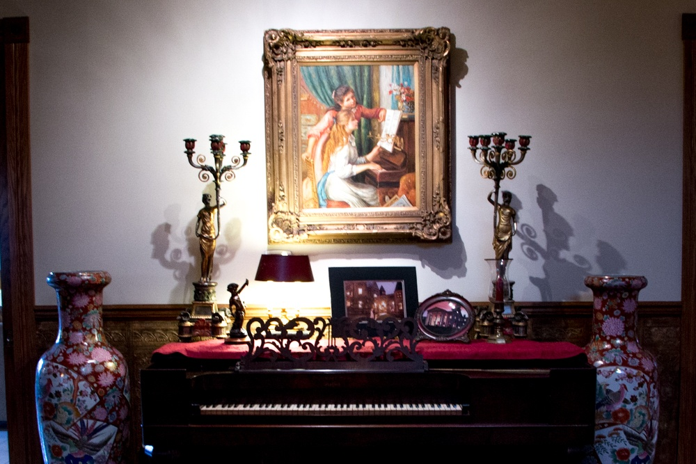 "This replica of Auguste Renoir's ""Girls at the Piano"" appropriately hangs above the 19th century Steinway at the Buhl Mansion. Romantic Weekend at the Buhl Mansion Sharon PA Pennsylvania, a Select Registry Hotel"