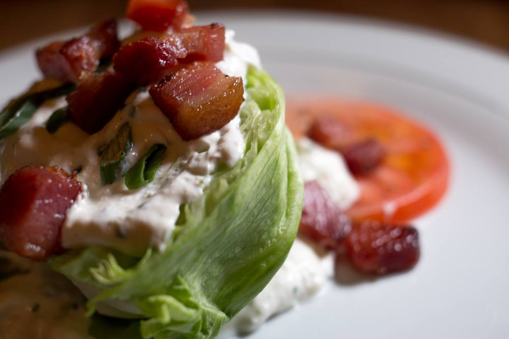 The Wedge with baby iceberg, house bacon, scallion, tomato and blue cheese dressing is a perfect starter when dining at Whitfield. The salad makes excellent use of local ingredients to provide an excellent update to this classic salad.