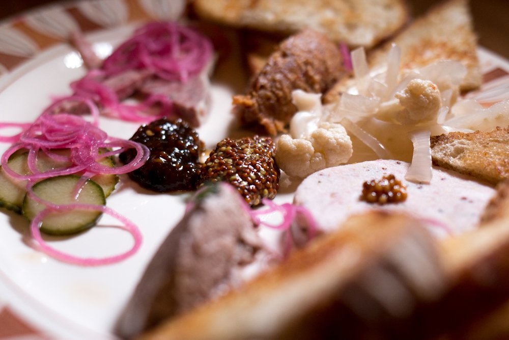 """The """"Butcher's Plate"""" with charcuterie, potted meat, pickles and mustard is a winner at the Whitfield. In this plate, the restaurant shows its chops with both the quality and presentation of the charcuterie and well chosen sides."""