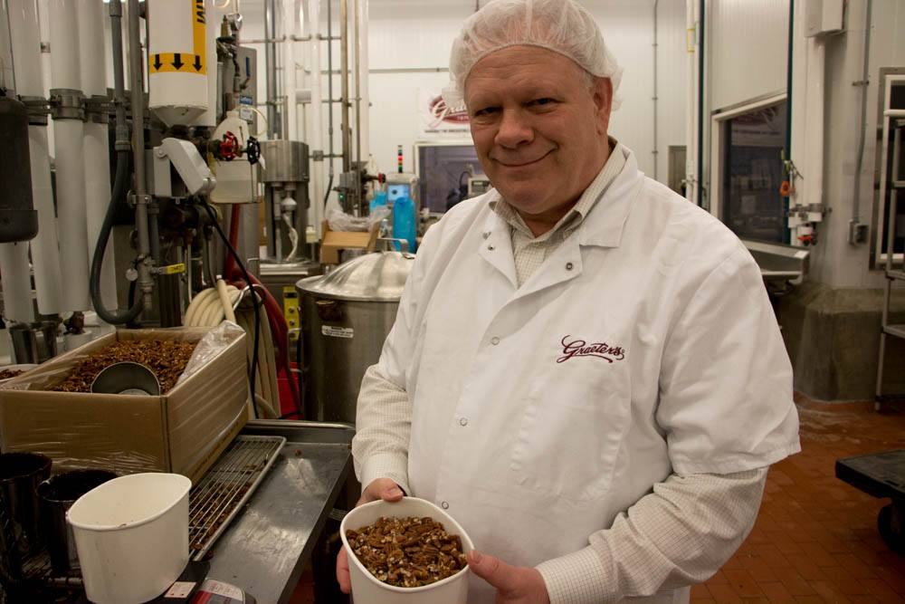 Bob Graeter proudly shows the pecans, just one of the fresh ingredients used to make Graeter's Ice Cream, during our factory tour. Inside Graeter's Ice Cream - A Cincinnati Icon 2foodtrippers Graeters Ice Cream