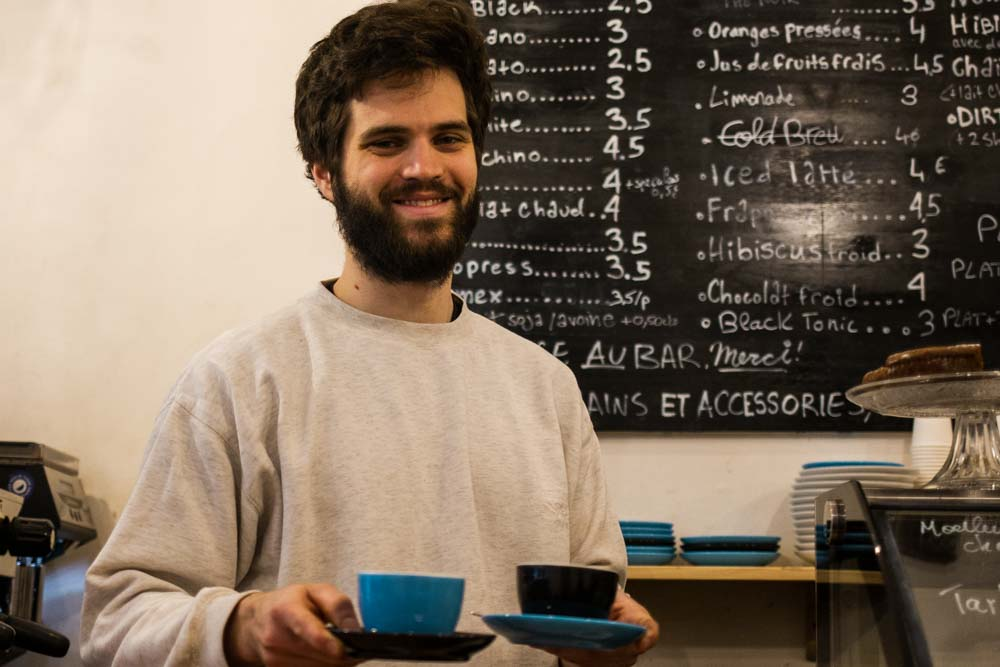 Barista at Puzzle Cafe in Lyon France