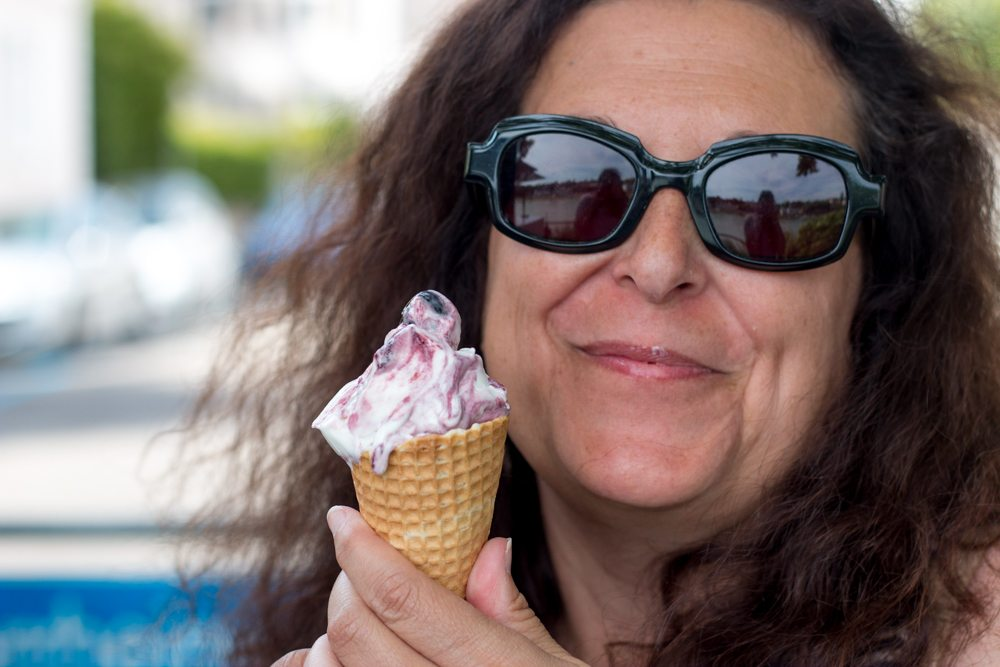 Mindi beats the heat with an amerena ice cream cone in Basel Switzerland. Things to Do in Basel Switzerland that Won't Break the Bank