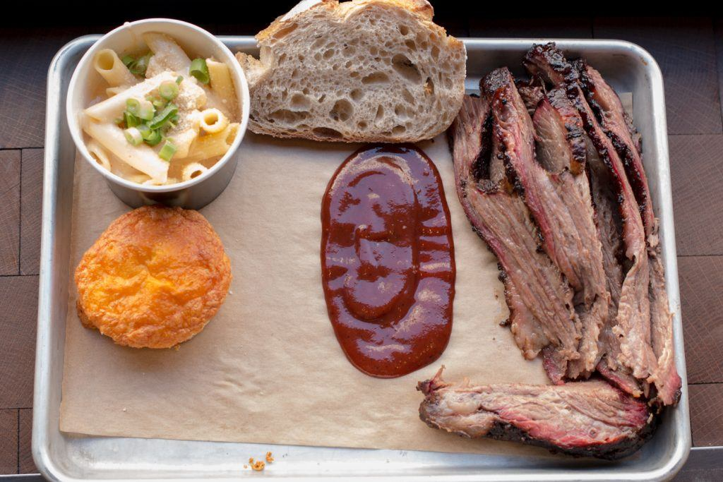 Texas barbecue in Paris? It turns out that the Parisians do an excellent job with American BBQ staples like brisket and beef ribs (a cut of the beef rib is shown on the bottom right) at The Beast. American Food in Paris 2foodtrippers