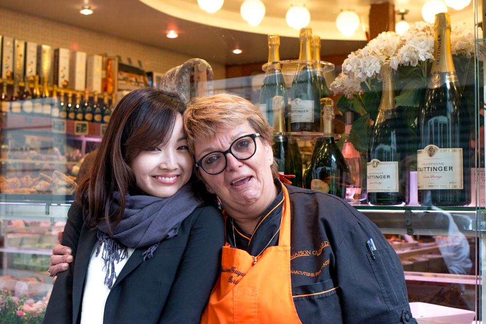 Cassandra Choi poses with Maison Guyard's Shop Matron, Colette during the Context Baguette to Bistro Tour. The tour provides tremendous insight into Paris food culture. Paris Food Tour
