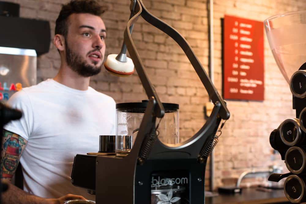 Barista Jason Liddell brews a 'perfect' cup of coffee with the Blossom Brewer at Brioso Roastery and Coffee Bar. Columbus Brew