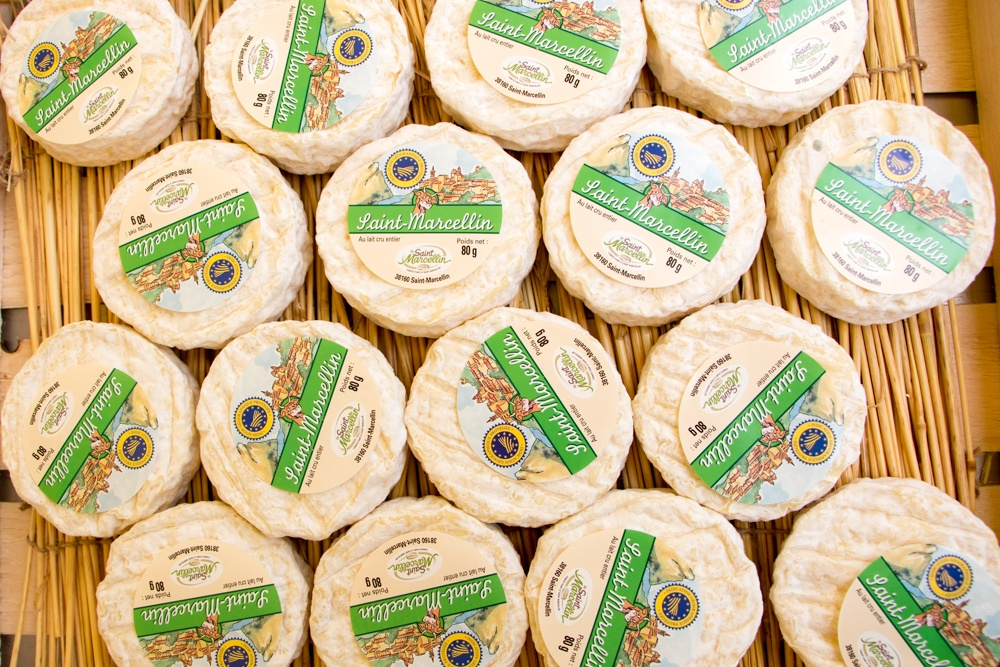 The Saint-Marcellin cheese produced in Saint-Marcellin France is a wondrously oozy cheese. fête du saint marcellin cheese france