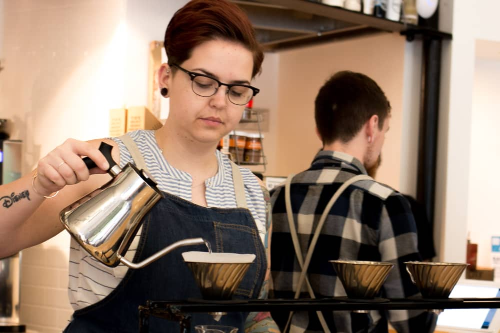At the Roosevelt Coffee House, Barista Bethaney Lovelace focuses on making a text-book pourover using a Hario V60 and Stumptown coffee. Columbus Brew