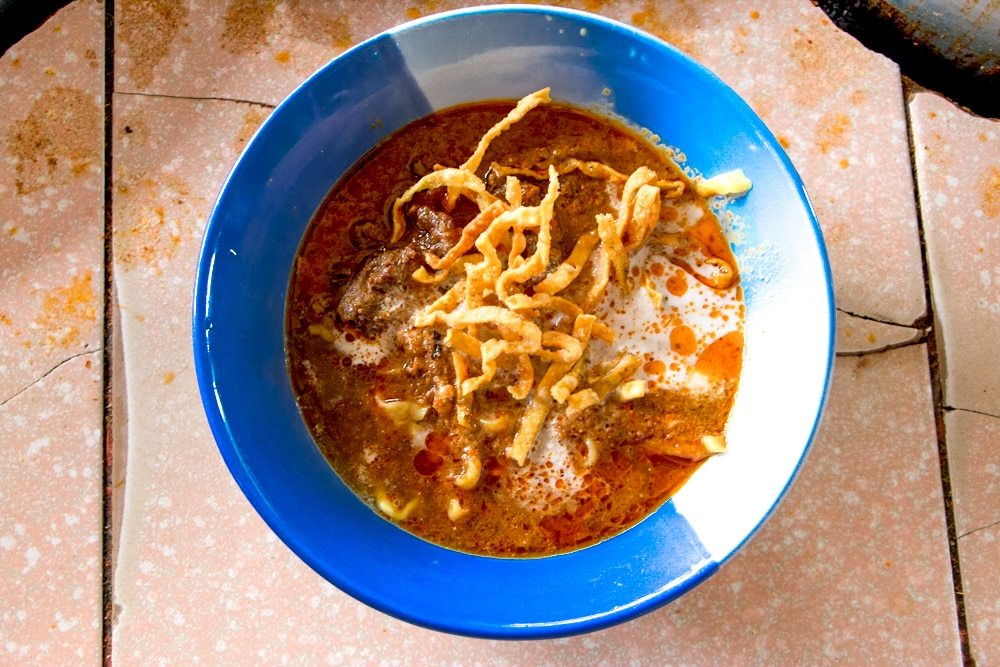 Bowls of Khao Soi at Khao Soi Lam Duan are cheap in price but rich in flavor. What to Eat in Chiang Mai - A Chiang Mai Food Guide 2foodtrippers