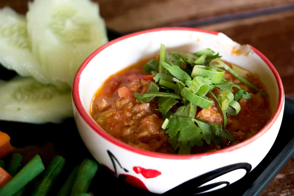 Nam Prik Ong features red curry as well as tomato, minced pork, coriander and chili. We devouredthis bowl at Khao Soi Nimman. What to Eat in Chiang Mai - A Chiang Mai Food Guide 2foodtrippers
